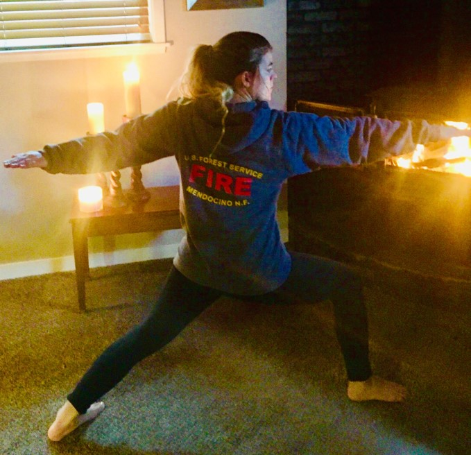 Kayla practicing yoga asana before a fire-fighting adventure.